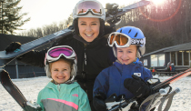 Mom and two kids with skis