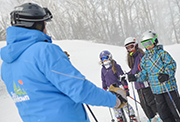 Ski Instructor teaching three students