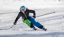Woman racing downhill on skis